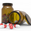 Stock Photo: Medicine capsules spilled from pill bottle