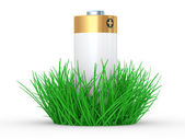 Green grass and battery, ecology concept — Stock Photo