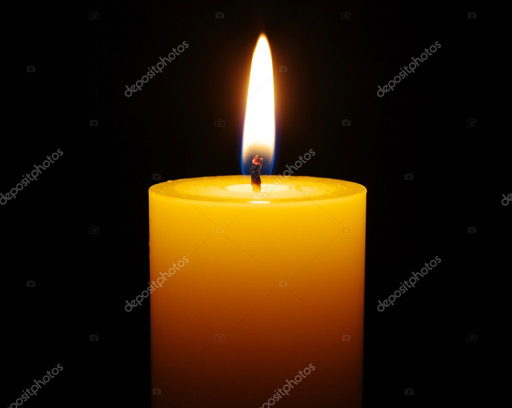 Burning candle isolated on black background  Stock Photo #10035274