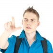 Young male entrepreneur pointing at copyspace — Stock Photo #9368459