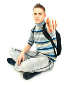 Attractive male student with backpack pointing at you — Stock Photo