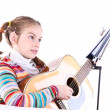 Girl playing acoustic guitar isolated on white — Stock Photo