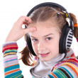 Happy little girl in headphones listens to music - Stock Photo