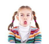 Close-up of a cute little girl sticking out tongue — Stock Photo