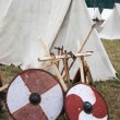 Two shield and some axes near tents — Stock Photo