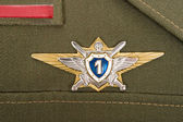 Russian military badge on the green uniform — Stock Photo