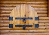 Rusty padlock on an old wooden window — Stock Photo