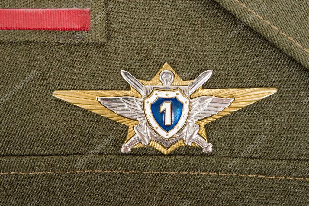 Russian military badge on the green uniform — Stock Photo #10104501
