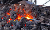 Forge with hot flaring coal — Stock Photo