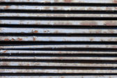 Old metal grate as the background — Stock Photo