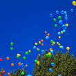 Balloons against the blue sky - Stockfoto