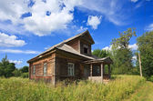 Old wooden house in russian village — Stock Photo