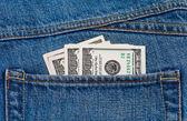Us-Dollar in die hintere Jeans-Tasche — Stockfoto