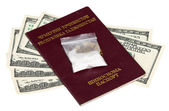 Package with drug over the Tajikistan passport and U.S. dollars — Photo