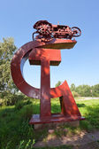 The first Soviet tractor of the twentieth century. A monument of — Stock Photo