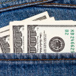 Stock Photo: U.S. dollars in back jeans pocket