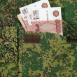 Banknotes in the military uniform pocket — Photo