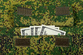 Banknotes in the military uniform pocket — Stock Photo