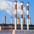 Lots of smoking chimneys other blue sky — Stock Photo