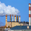 Lots of smoking chimneys other blue sky — Stock Photo #9468053