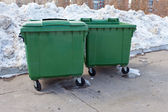 Two green recycling containers in winter park — Stock Photo
