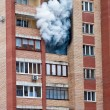 Fire in one of the apartments of a large tenement-house — Stock Photo