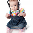 Baby in headphones — Stock Photo