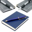 Stock Photo: Notepads and ballpoint pens