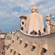 Tourists on the roof of Casa Mila House (La  Pedrera), Barcelona - Stock Photo