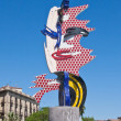 "Photo: Sculptor Roy Lichtenstein, entitled ""Face of Barcelona."" Spain"