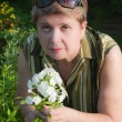 Portrait of a woman with a blooming phlox — Stock Photo