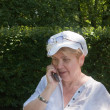 The adult female has a telephone conversation — Stock Photo