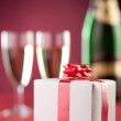 Romantic gift box, two glasses and a bottle of champagne. — Stock Photo