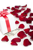 Gift box, rose petals on white background. — Stock Photo