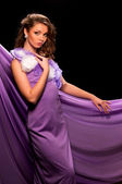 Woman in the purple dress — Stock Photo