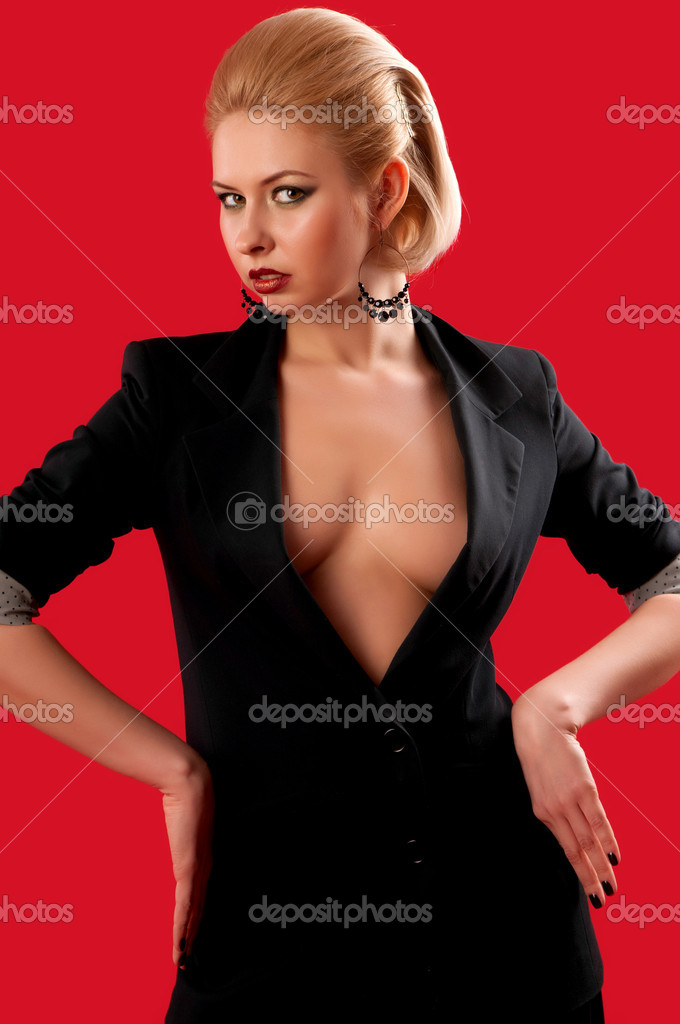 Blonde girl in a black suit with a red background — Stock Photo #10048370