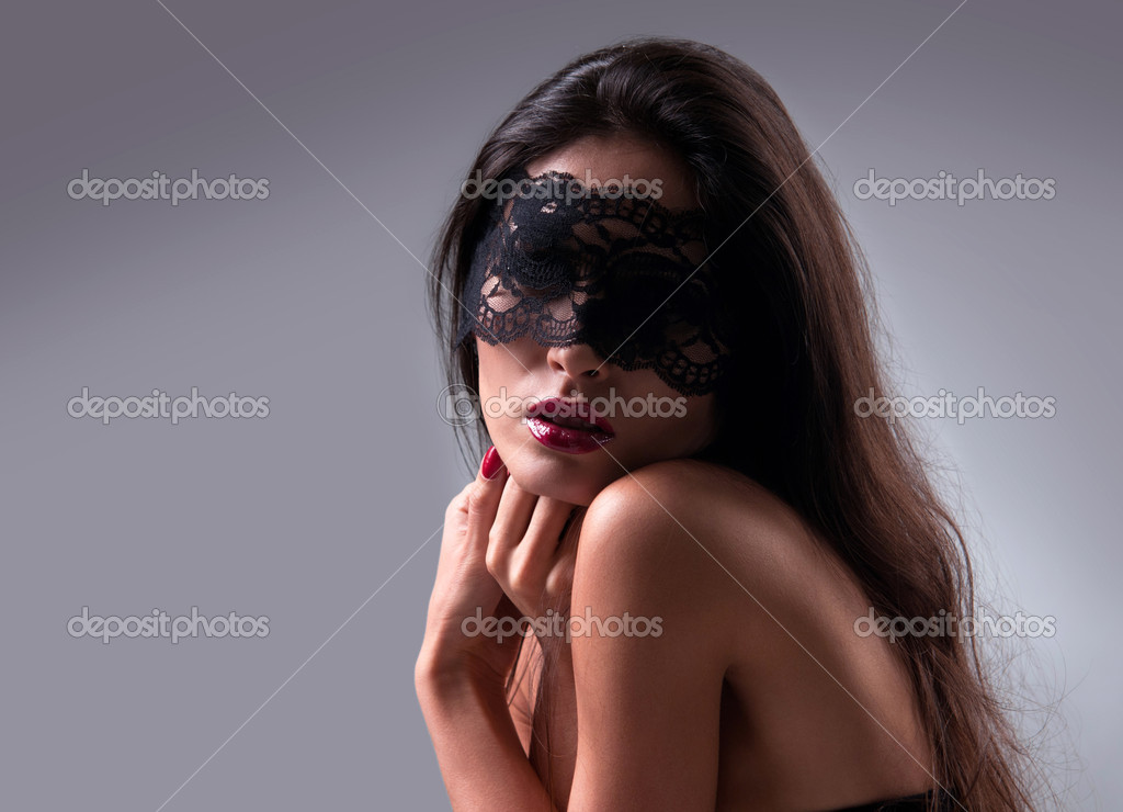 Portrait of a girl in a mask with a gray background — Stock Photo #10183852