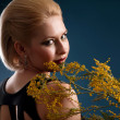 Blonde woman with a branch — Stock Photo