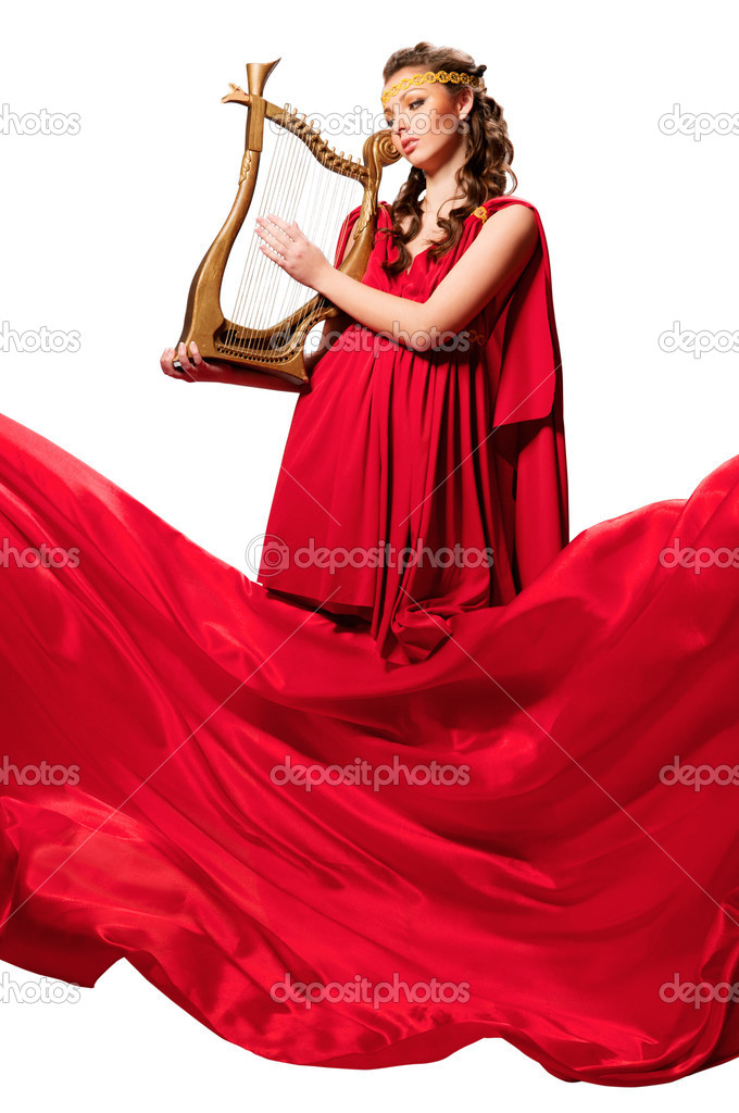 Beautiful girl in a red dress with a harp in his hands. Isolated background — Stock Photo #10533642