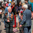 Stock Photo: DONETSK, UKRAINE - MAY 9 Unidentified veterans at Victory Monume