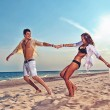 Boy and girl running on beach — Stock Photo