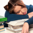 Girl sleeping on a stack of books - Stock Photo