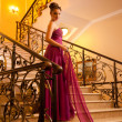 Woman in a beautiful dress sloit on the stairs — Stock Photo #8109886