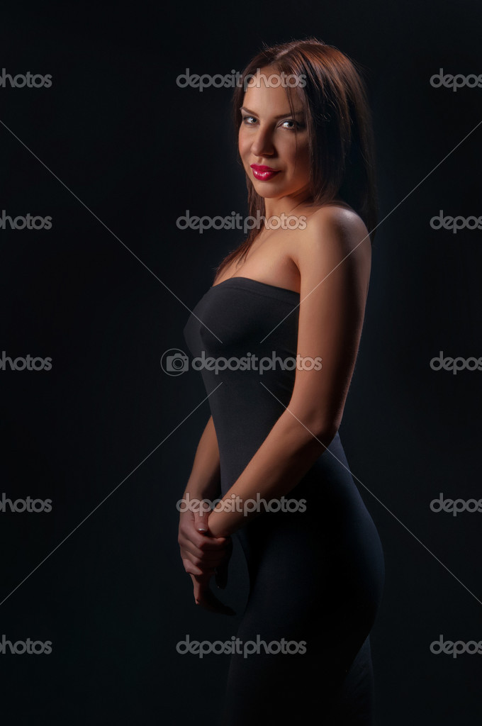 Fashion girl posing on dark background - portrait — Stock Photo #8100365