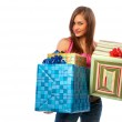 Woman holding boxes with gifts — Stock Photo