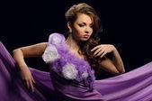 Beautiful girl in a purple dress — Stock Photo