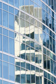 Reflection in glasses of a building — Stockfoto