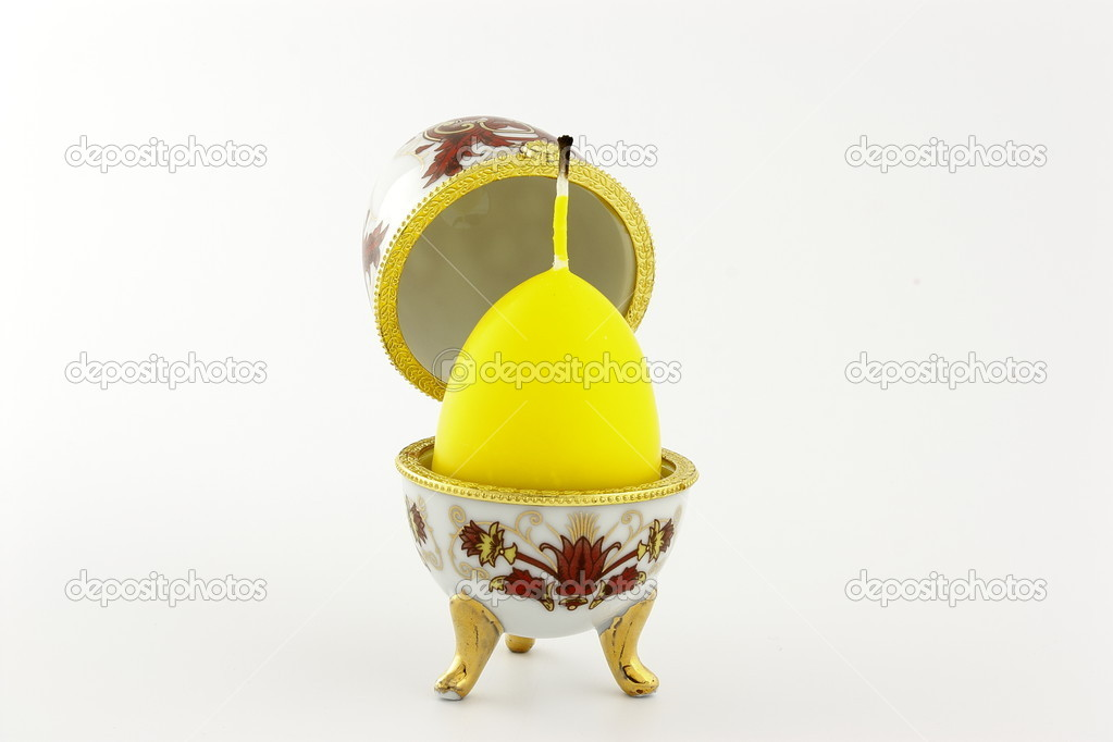The box shape in the style of Faberge egg with a candle — Stock Photo #10409278