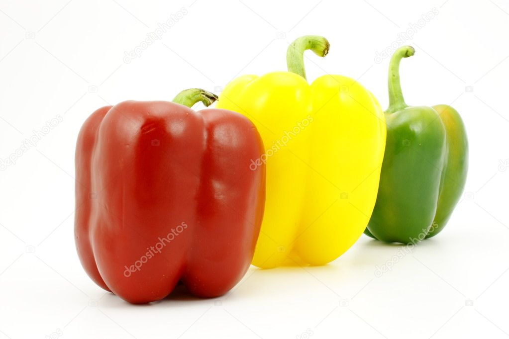 Colored peppers on a white background — Stock Photo #10444680