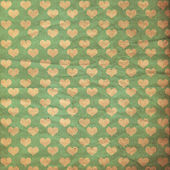 Vintage image with grunge paper with hearts — Stock Photo
